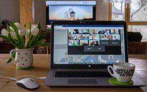 laptop showing remote meeting taking place